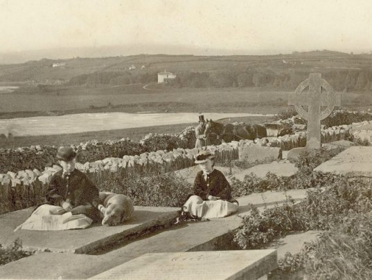 An albumen black and white print taken some time in the 1860s showing two women sitting amongst tombstones in a graveyard in Killimer Co. Clare. Of the graves is that of of Ellie Hanley, the Colleen Bawn. From the Vandeleur Albums, Clare County Library. Posted by Ciarán Walsh, www.curator.ie.