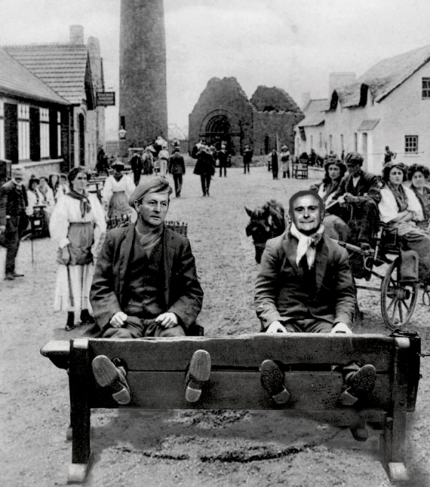 This image, a photomontage by Ciarán Walsh (Ballymaclinton.wordpress.com / www.curator.ie)   shows the main square of Ballymacclinto where Enda 'Krony' Kenny and his partner in crime Brendan 'I Can Explain' Howlin have been placed in the stocks because of the cronyism scandal, placing political cronies on state board as payback for political loyalty.