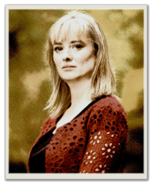 An illustration based on a photograph by Gerry Mooney of Mairia Cahill who is at the centre of a political row over rape by a senior IRA man. Cahill is posed in profile with long blonde hair and a red crochet top over a black dress. The image has been manipulated by Ciarán Walsh of www.curator.ie to make it look like a turn of the century photograph of 'The Colleen Bawn.'