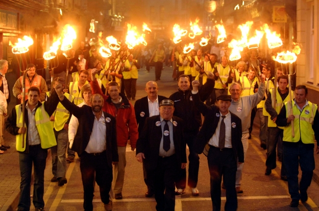 Don Mac Monagles classic photograph of Jackie Healy Rae's torch lit procession during the Irish parliamentary election of 2007. Featured by Ciarán Walsh in a review of 100 years of photography by the MacMonagle family.