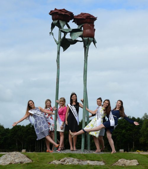 REPRO FREE Haley O'Sullivan 2013 Rose of Tralee with New Zealand Rose Lisa Bazalo , Western Canada Catherine Joyce , Donegal Rose Tamara Payne , Texas Rose Cyndi Crowell , Washington Rose Allison Wetterauw and Perth Sinead Lehan . Roses and minister Donohoe TD arive to officially unveiled the Roses sculpture on the Tralee Bypass today . Photo By : Domnick Walsh / Eye Focus LTD © Tralee Co Kerry Ireland Phone Mobile 087 / 2672033 L/Line 066 71 22 981 E/mail - info@dwalshphoto.ie www.dwalshphoto.com PRESS INFO - Minister Donohoe unveils Roses Sculpture on Tralee Bypass . Minister for Transport, Tourism & Sport, Mr. Paschal Donohoe TD officially unveiled the Roses sculpture on the Tralee Bypass on Monday, August 18th 2014.ÔThe RosesÕ sculpture which consists of three red roses on their stems was created by Mayo sculptor, Rory Breslin, as part of the Percent for Art Scheme for the Tralee Bypass. Kerry County Council also provided funding for the project.Situated beside the roundabout linking the Tralee Bypass to the N22 Killarney road, the Roses sculpture highlights the well-known symbol of the Tralee area. It also links to the famous Rose of Tralee song which speaks of William MulchinockÕs love for Mary OÕConnor, who was employed a maid by the Mulchinock family.Speaking at the official unveiling of the sculpture, Minister Donohoe congratulated all involved in both the construction of the Tralee Bypass and also in the creation of the sculpture. The Minister pointed to the success of the Tralee Bypass in diverting through traffic from Tralee town centre and reducing travel times for motorists in the area.Speaking at the unveiling Minister Donohoe said: ÔIt is important that we continue to support our artists through the Precent for Art scheme, which allows for a portion of the cost of a public infrastructure project to be ring-fenced for the commissioning of a work of art. ÒIconic installations such as this very quickly become a symbol of the area, and t